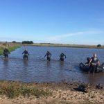 Rastrillaje en las aguas para hallar a Onrrubio: Mirá en fotos el trabajo de los buzos
